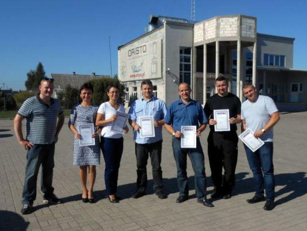 English language students at Oristo, Montowo with their certificates. Tutor Matt Purland is far left.